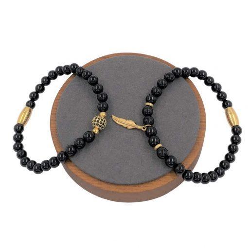 תמונה של סט צמידים לגבר בצבע שחור עם אלמנט זהב
