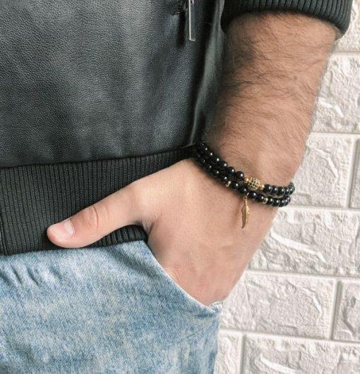 תמונה של סט צמידים לגבר בצבע שחור עם שילוב זהב