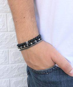 תמונה של סט תכשיטים לגבר בצבע שחור וכסף